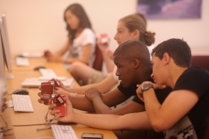 Students Josdanson Exume, left, and Telmo DeMorais, both of St. Benedict's Preparatory School in Newark, N.J., work on a video during computer lab time.