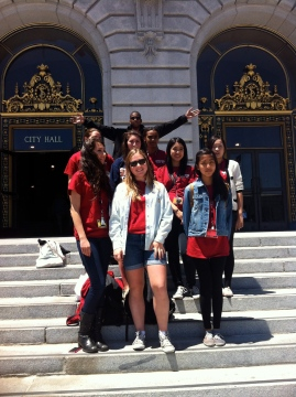 Team leader Brooke Stobbe, center, and members of the Flame team outside San Francisco City Hall, one of several locations they visited on their field trip to the city. Photo by NBTB students/staff.