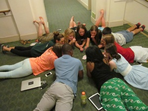 New friends play a game of cards in the hallway of our Stanford dorm. After a long day of orientation and brainstorming themes with their team leaders, students enjoy relaxing together. The fun is just beginning!