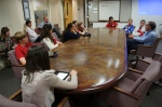 Students gather around the conference table at the San Francisco Chronicle for a talk with John Diaz, editorial page editor.