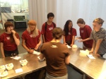 Students line up for a gourmet taste test at the TCHO chocolate factory in San Francisco. Photo by NBTB staff.