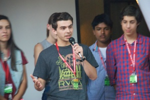 Simon Greenhill takes the mic during the multimedia showcase to describe his team's pop-up website project.