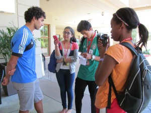 Esme Argueta, center, interviews a San Jose Earthquakes player during NBTB 2013.
