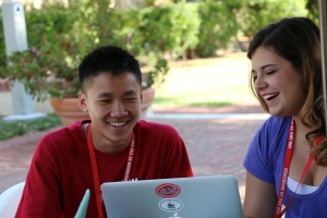 Student Tim Lan (left) and team leader Alexandria Cremer work on a video about discrimination in the media against Asian Americans, at NBTB 2015.